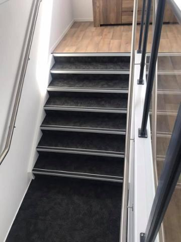 Commercial Carpet tile installed on stairs with safety stair nosings